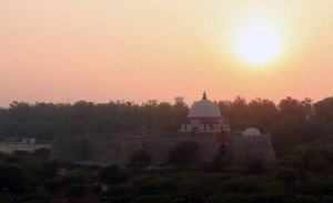 The sun setting over Ghiyasuddin Tughlaq's Tomb.
