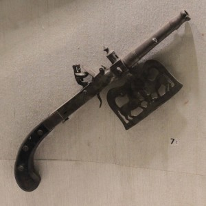 Pistol attached with a battle axe.