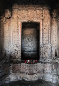 Inside Vamama Temple, looking in to the inner sanctum with statue of the dwarf incarnation of Vishnu.