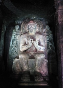 Buddha on a lion throne in a preaching posture inside Cave No. 16.