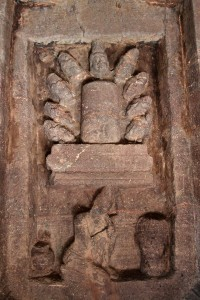 Relief of a linga and multiple heads.