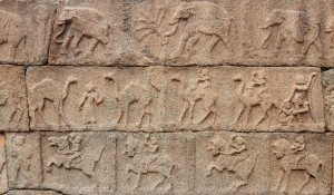 Reliefs of animals and riders decorating the walls of Mahanavami Dibba.