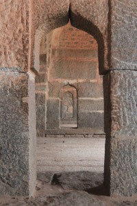 Inside the Elephant Stables, looking through the openings between each stable.