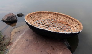 Round boat (made from weaved reeds, covered with sack-cloth, and coated in tar) used by locals on the river.