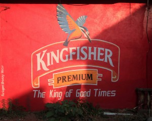 Advertisement on the side of a store for Kingfisher beer - India's primary brew.