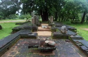Ruins with yoni and linga statues.