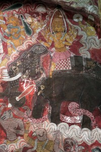 Painting of an elephant and rider on the cave temple ceiling.