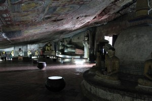 Stupa and a reclining Buddha inside the Dambulla Cave Temple.