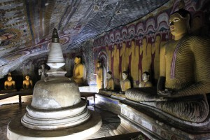 Stupa and Buddha statues in another small cave in the Dambulla Cave Temple complex.