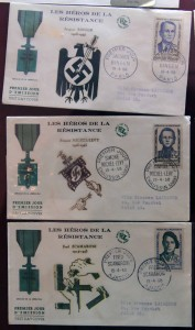 French letters and stamps honoring heroes of the Resistance during World War II.