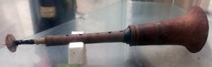 Wooden trumpet.
