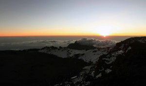 The sun rising, seen from Uhuru peak on the outer rim of Kibo.