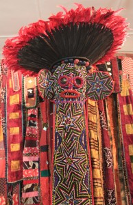 Mask and feathered hat from the Bamileke tribe in Cameroon.