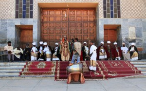 Ethiopian Orthodox religious figures in front of the Church of Our Lady Mary of Zion.