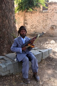 The man (and the AK-47) assigned to guard the Chapel of the Tablet.