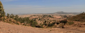 The Ethiopian countryside with mountains seen far away in the haze.