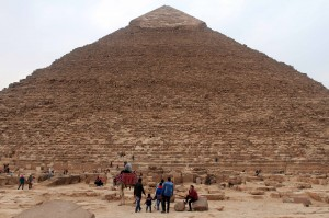 "Tourists climbing on the Pyramid of Khafre (also known as the ""Pyramid of Chephren"")."