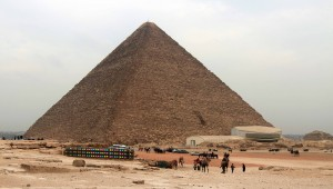 "The Great Pyramid of Giza (also known as the ""Pyramid of Khufu"" or the ""Pyramid of Cheops""), the oldest and largest of the three pyramids in the Giza necropolis, built during the Fourth Dynasty."