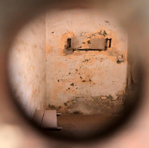Peeping in to a prison cell in the Citadel's Prison Museum.