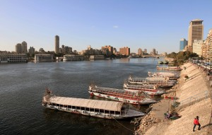 Boats tied along the bank of the Nile River.