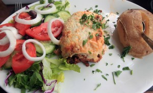 Moussaka with a salad and baked potato.
