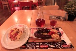 Chicken souvlaki wrap, grilled pastourma sausages, and Cretan Rosé wine.