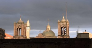 Bell towers, domes, and a minaret.