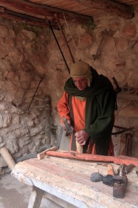 A carpenter creating a plow.