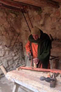 A carpenter creating a plow.