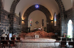 Inside the Church of the Primacy of St. Peter - the exposed rock is where the meal took place.
