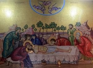 Mosaic depicting Christ's body being prepared for burial.