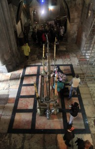 Looking down at the Stone of Anointing, where Christ's body was prepared for burial, inside the Church of the Holy Sepulchre.