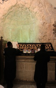 Rabbis praying at the Tomb of David.