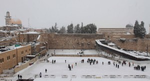 The Western Wall courtyard covered in snow.