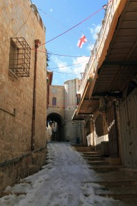 Street in the Old City partially covered in snow.