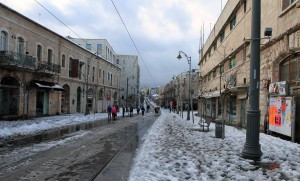 Walking back on Jaffa Road as the snow is melting.