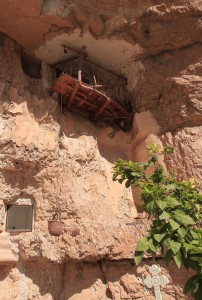 Balcony of a monk's cave and a basket on a pulley above the monastery.
