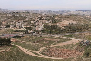 Looking toward Bethlehem from Herodium with ruins of the pool complex and Lower Herodium at the bottom.