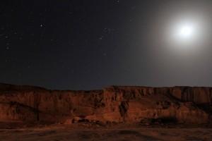 The desert near Wadi Rum with the Half Moon shining bright above.