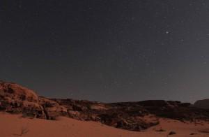 More stars and desert at night.