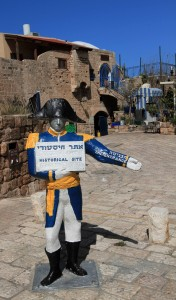 Figure holding a sign to let all tourists know that they are in a historic site (i.e. Old Jaffa).