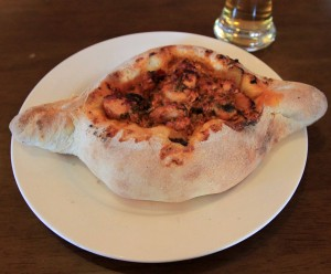 Acharuli (with chicken stew in a bread-shaped boat).