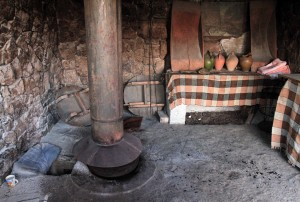 "Armenian tonir (their version of ""tandoor"") with flue over it."