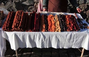 Dried meats and fruits on sale outside of Geghard Monastery.