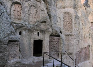 The entrance to a monk's cell, carved in to the cliff at Geghard Monastery.