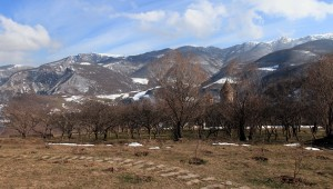 Orchard with the Tatev Monastery complex behind it.