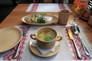 Poltava (soup with chicken balls and halushkas (pieces of dough)) and slices of veal tongue baked in spices with cucumber slices and mayonnaise.