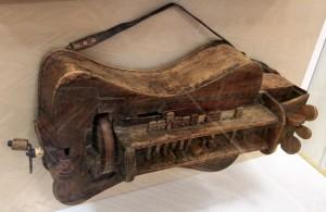 Interesting musical instrument (a precursor to the keytar?).