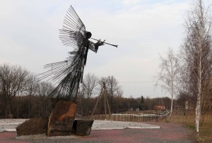 Monument to the heroes of the disaster in the center of the town of Chernobyl.