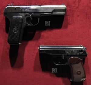 TT pistol (top) and a Makarov pistol (bottom).